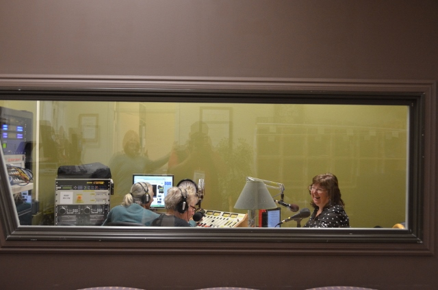Elaine B Holtz interviewing Julie Combs with Ken Norton at the soundboard in Radio KBBF's new studio
